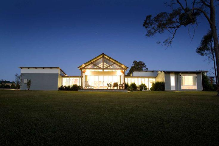 The Farm House. External, front-end elevation, dusk.