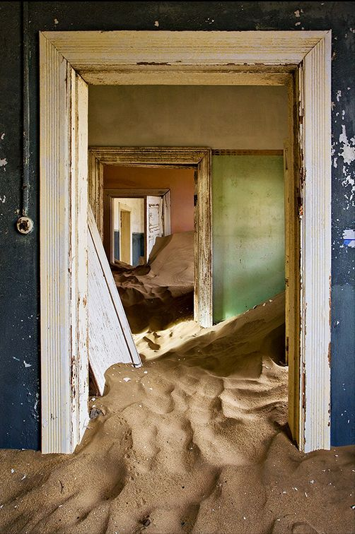 Kolmanskop - Namibia. The desert is reclaiming the old mining town which was founded around 1908 when the first diamond was discovered there. Now it's a mere ghost town.