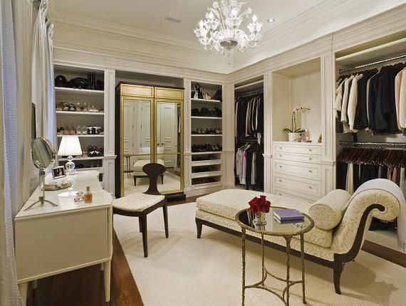 A combination closet and dressing room, complete with dressing table via Random Inspiration.