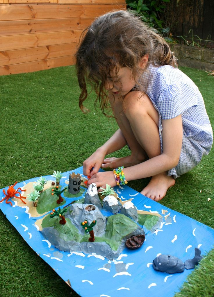 """diorama made by kid, here with papier mache and to create a """"story island"""" of her design (objects and whole diorama based on story made up by child)... any material could be used to make the diorama though, and there wouldn't have to be an explicit story (just a certain type of scene) other story islands: https://www.google.com/images?q=Story+Island+Project"""