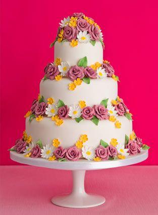 'Purple Rose and Buttercups' wedding cake : Chocolate fudge cake,   Amedei Toscano chocolate buttercream, handmade sugar flowers  and leaves.