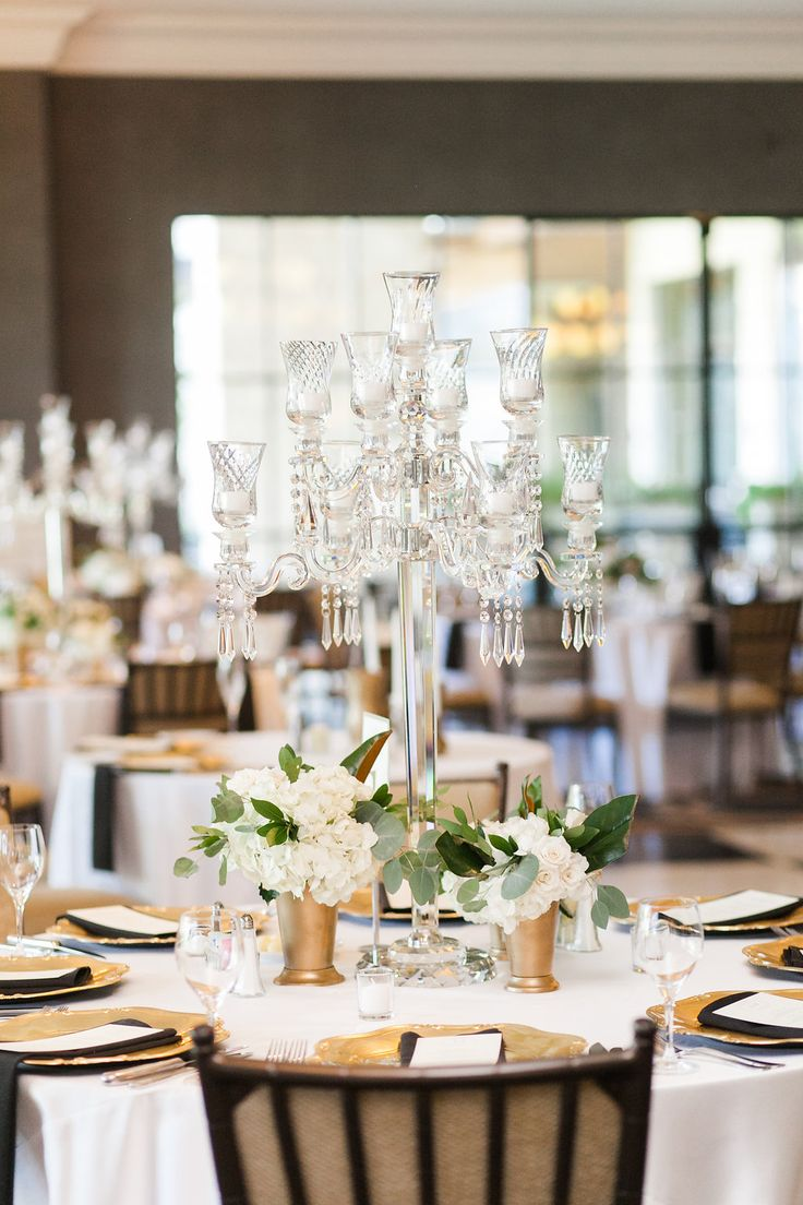 Centerpiece inspiration: crystal candelabras with simple floral and candles at the base.  STEMS | Mint Photography | Austin Country Club