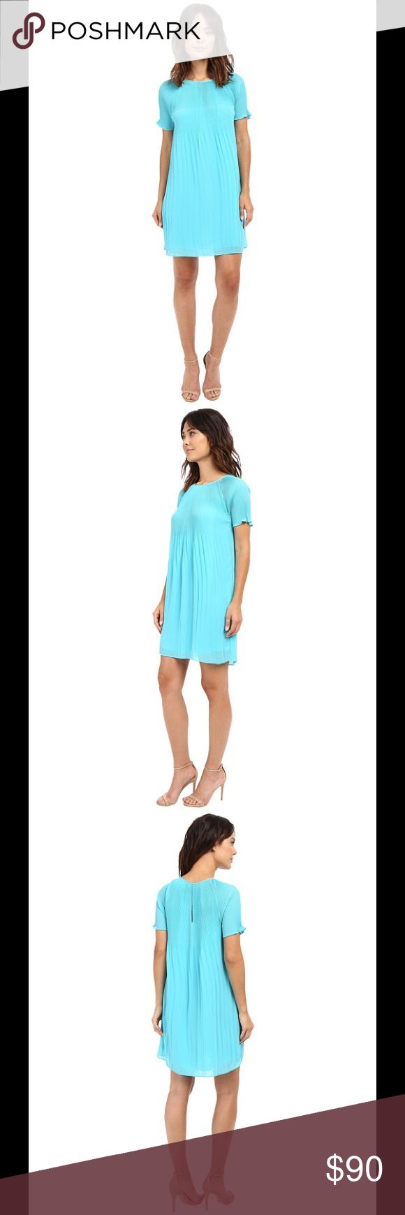 Michael Kors Pleated Shift Dress Turquoise size M MICHAEL Michael Kors Women's Pleated Shift Dress. In color Turquoise. Size M. Material Polyester, lining Polyester. Scoop Neckline. Back Keyhole Button Closure. Short Sleeves. Allover Pleats. Shift Silhouette. Lined. Hits Above Knee. Pretty pleats define this flawless shift dress in Turquoise from MICHAEL Michael Kors. It's the perfect pick for date night and beyond. Made in China. MSRP $150. MICHAEL Michael Kors Dresses Mini