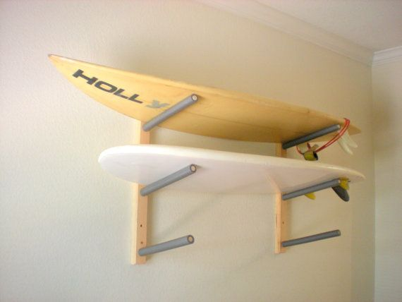 Store up to 3 of your surfboards or wakeboards in style with this attractive wall rack. This rack is handcrafted with routed edges and padded arms.