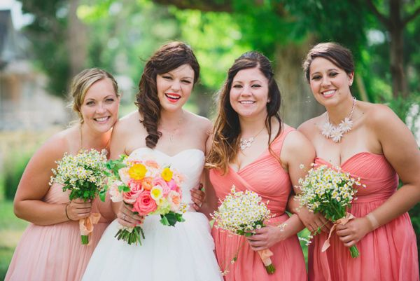 salmon bridesmaids dresses // photo by June Cochran, flowers by Cori Cook Floral Design // View more: http://ruffledblog.com/colorado-country-wedding/