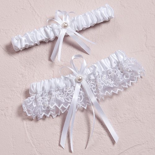 Handcrafted details, delicate sheer fabric and exquisite embroidery make this wedding garter set extra special. The detailed ribbon and pearl accent add elegance to this white bridal accessory. Fabric
