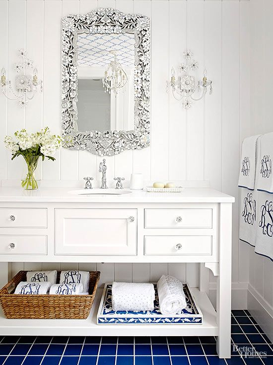 Convert an existing dresser into a bathroom vanity with a custom countertop that has a fitted sink and faucet.