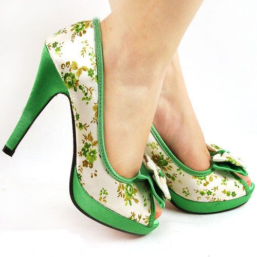 I am exactly the kind of girl who would buy these shoes!!!! (dosn't everyone need a perfect pair of retro-style-high-heel St-Paddy's -day shoes? I know I do....)