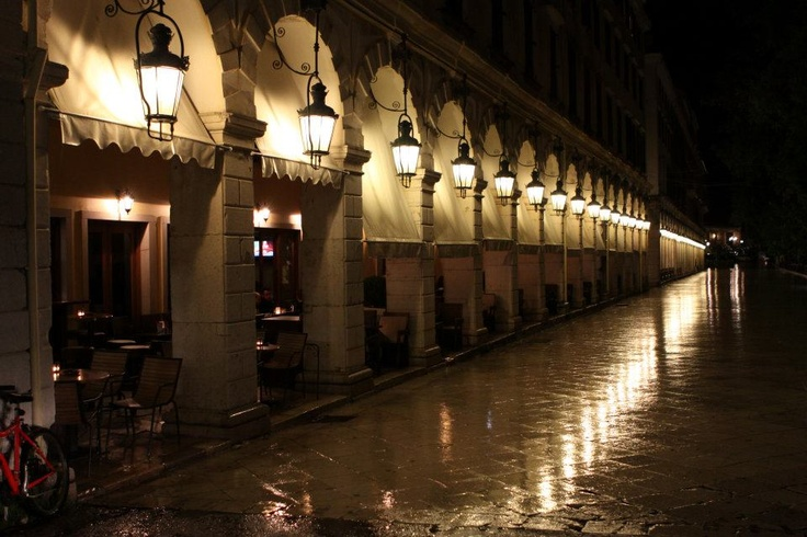 Corfu: Spring rainy night .Liston was built by the French {1807-1814} , on designs of the engineer Lesseps {father of the engineer who constructed the Suez canal} ,based on the model of the Rue de Rivoli buildings.