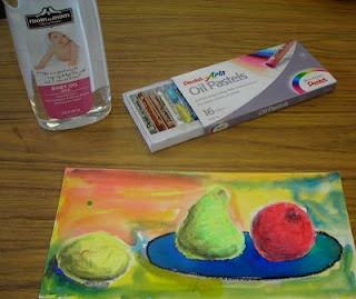"""""""After drawing on paper, fill some small jars with baby oil, pop in a ear swab or qtip and then using the qtip, place the baby oil over the oil pastel drawing...it turns the oil pastel to paint. It's a wonderful experience."""""""