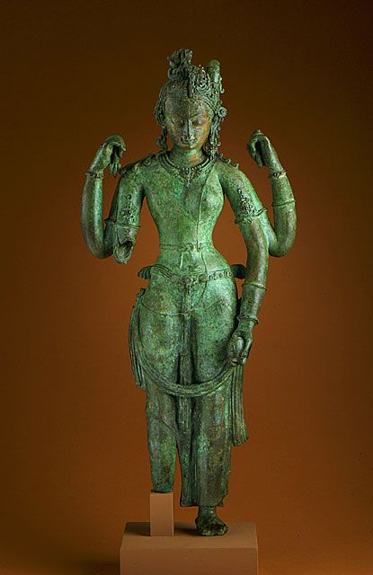 ca. 1000 CE. Ardhanarishvara, Nepal, the the united form of Shiva and Parvati. male and female. Unalloyed copper, inlaid garnets and an emerald; traces of paint.
