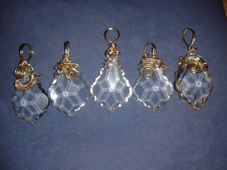 Wire wrapped chandelier crystals, for use as Christmas tree decorations. These decorations use 14k gold rolled wire.