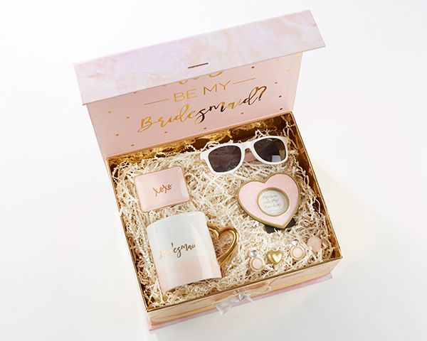 Kate Aspen's Pink and Gold Will You Be My Bridesmaid Kit includes 4 magnets, 1 mug, 1 pair of sunglasses, 1 frame, and 1 trinket dish all in a gift ready box with sleeve.