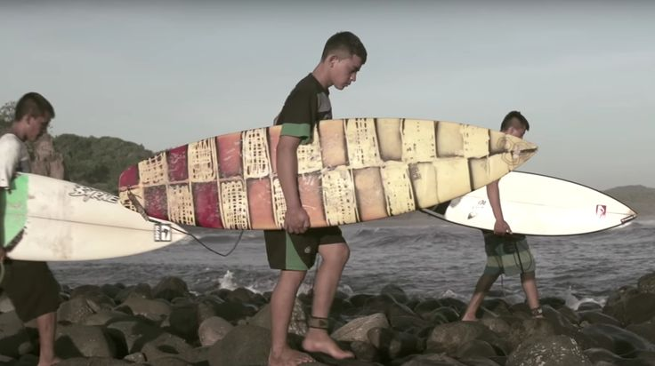 Billy Antonio, Milton Isaac, and José Baltazar let off some steam by catching waves.