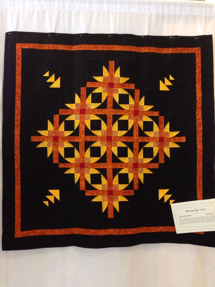 I love this quilt pattern - Mexican Star, in hot colors on black. Shown at Burlington Quilt Guild show October 2014. Won 1st place ribbon in Topsfield Fair 2015