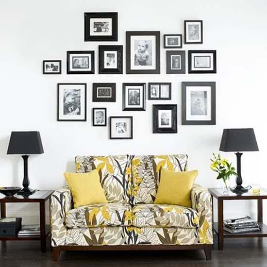 I love the horizontal line between the pic frames in the wall. - Decorating with old picture frames