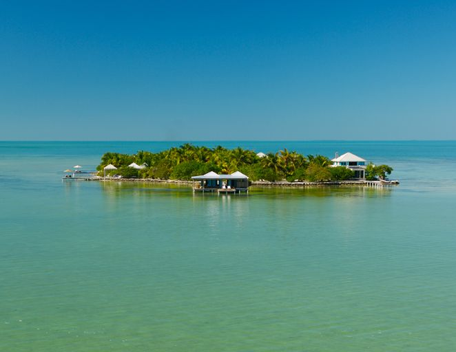 Cayo Espanto, Belize - This teeny, super-chic one-resort private island, located off the coast of mainland Belize, lets you focus solely on your newly minted spouse and completely escape from reality. | The Knot