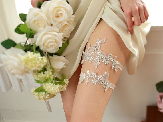 STYLE - #417 CODE:GRT025 Silvery lace garter set. Sparkling garter set feature heavily beaded silver floral lace, hand-sewn to organdy elastic band. Romantic and eye-catching garter set for your wedding ensemble. To order yours contact us at loca@localoca.co.za www.localoca.co.za