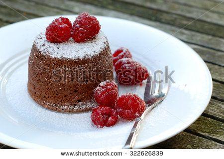 Chocolate cakes with raspberry - stock photo