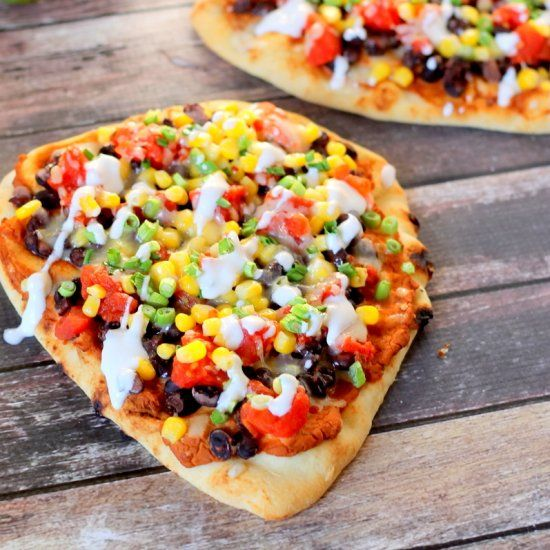 Naan topped with creamy chipotle bean spread, black beans, tomatoes, corn, peppe… – Colleen Maine