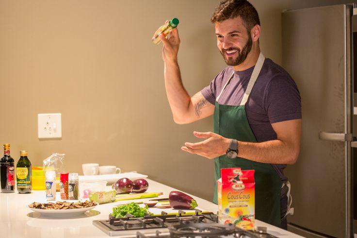 J'Something demonstrating his salad of grilled brinjals.