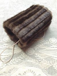 Beautiful handmade vintage style faux fur hand muff for girls.  Available to buy at www.ruralmagpie.co.uk