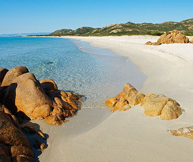 Bidderosa Beach, Orosei, Sardinia, Italy  Not all of Sardinia is blinged-out like the Costa Smeralda. Head south to the 15th-century village of Orosei, whose historic center is made up of old stone houses like the cheerful Anticos Palathos B It shares the same pale white sands and transparent azure waters as up north, but not the crowds, thanks to the two-mile walk to get there, off a poorly marked exit on the SS125 highway. anticospalathos.com