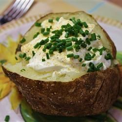 """Garlic Baked Potato   """"Nice, easy twist on a baked potato. Even my 3 year old liked it and ate the skin! I brushed the olive oil on the potatoes instead of using a plastic bag. Will definitely make this again."""" -sweetestgoodbye"""