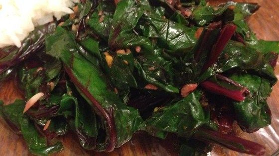 Don't throw away those hearty green leaves that top fresh bundles of beets! They have a flavor similar to kale.  This simple recipe will will help you make the most of your fresh beets!