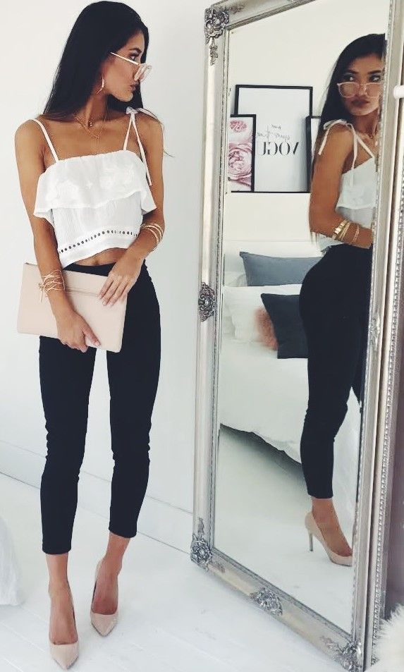 solid white spaghetti strap tank, with ruffle at top + black, ankle length, high waist skinny jeans + nude stiletto pump heels