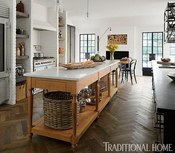 Walnut cabinets and drawers were given brass edging—masculine meets elegant in this kitchen. - Photo: Werner Straube / Design: Summer Thornton
