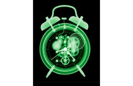 An X-ray of a traditional alarm clock by Nick Veasey.