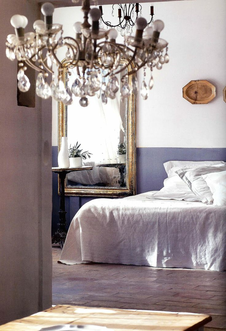Large wall mirror, crystal chandelier and white bed throw - so romantic <3