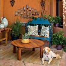 Located just off the kitchen, this patio nook features a latilla-style roof made of ocotillo branches designed to allow in air and filtered sunlight.  #phgmag