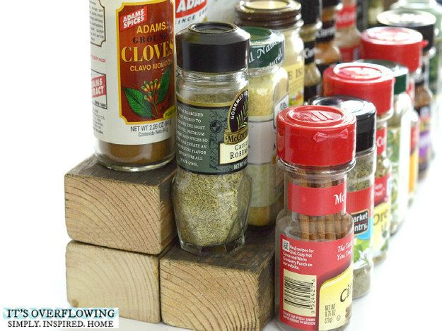Use three small pieces of wood to make your spices easy to see in your cabinet. | 7 Quick Ways To Actually Declutter Your Life