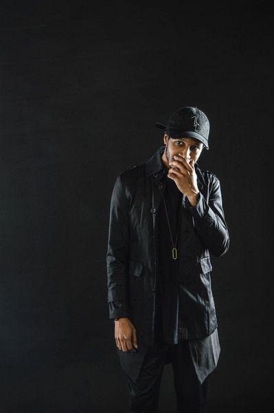black distressed baseball cap + strapped trench coat +  long vest