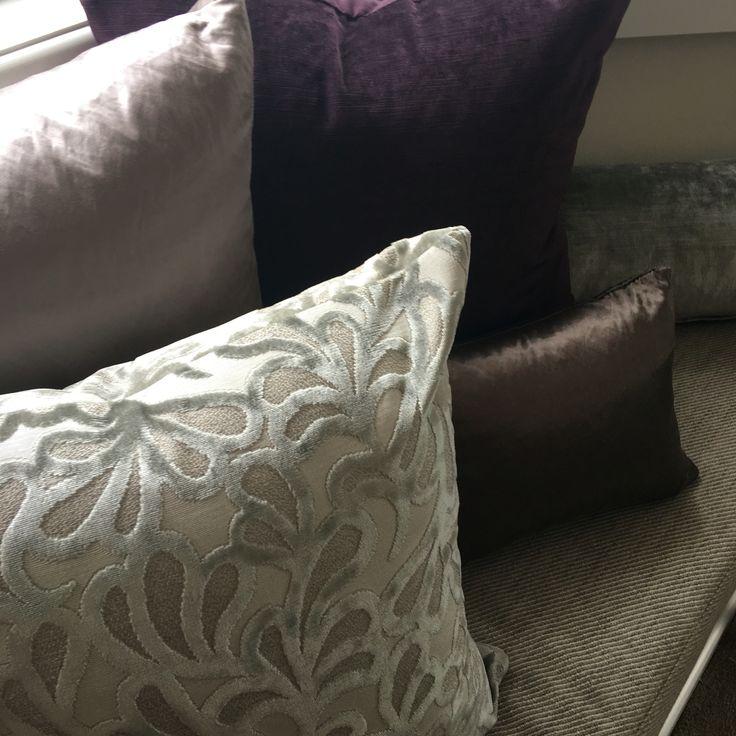 Beautiful soft furnishings in smoky hues and purple.