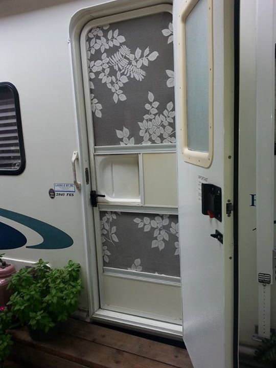 Lacy screen door on travel trailer