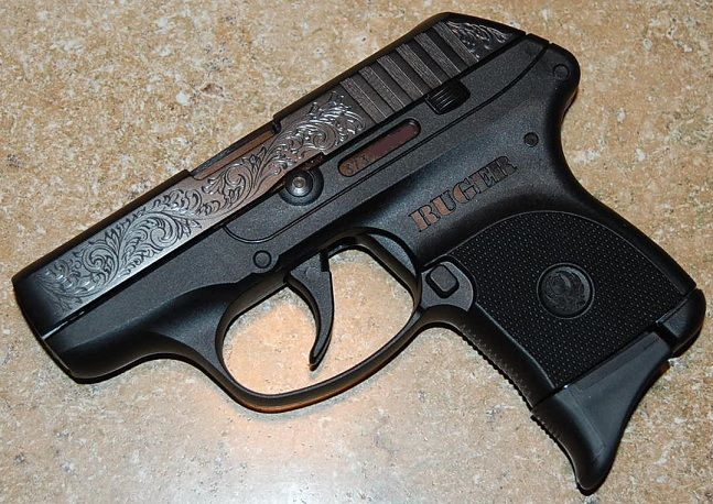 Love the engraving and scrollwork - I miss when weapons were designed with beauty in mind.