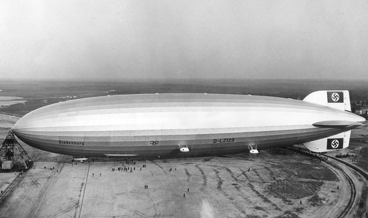 The giant German zeppelin Hindenburg, in Lakehurst, New Jersey, in May of 1936. The Olympic rings on the side were promoting the 1936 Berlin Summer Olympics. (OFF/AFP/Getty Images) #