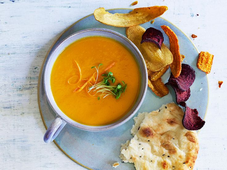 This vegetarian carrot and butternut squash soup spiced with curry and served with naan bread is so easy that it'll become your new go-to weeknight dinner.