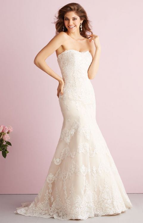 Allure Bridal- 2712: Exquisite lace detailing is featured on this ultra-feminine strapless gown, along with a chapel length train.