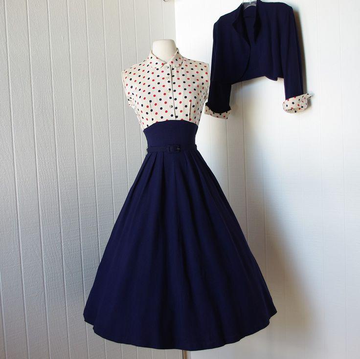 vintage 1940s dress  ...fabulous WWII navy blue full skirt pin-up dress with polka dot bodice and bolero jacket. $170.00, via Etsy.