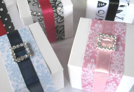 Decorated White Boxes with Patterned Papers & Diamonte Buckle. Boxes from Kelly Beans Bomboniere... see more at http://kellybeans.brisbane.weddingcircle.com.au