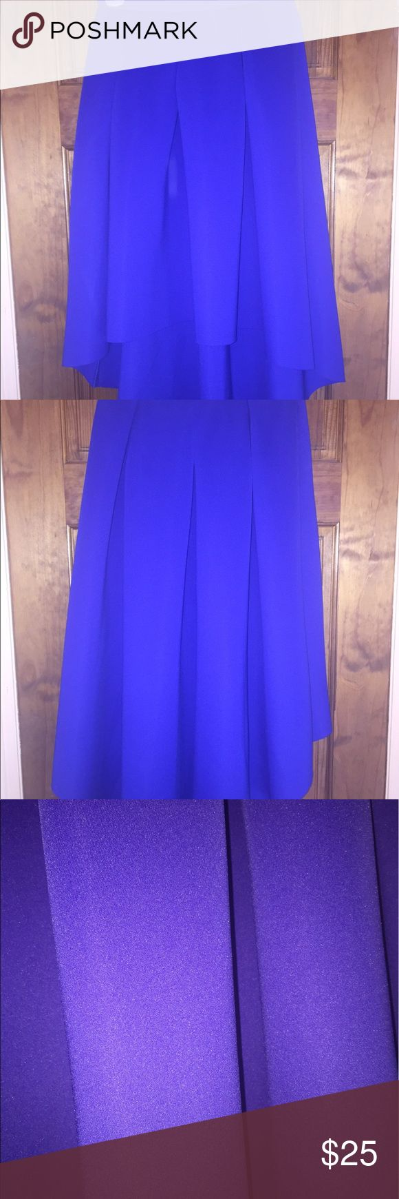 Royal Blue High Low Midi Skirt Royal Blue High Low Midi Skirt. The waist line does not have a zipper Skirts High Low