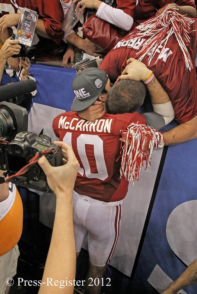Aj McCarron hugging his father after winning National Championship