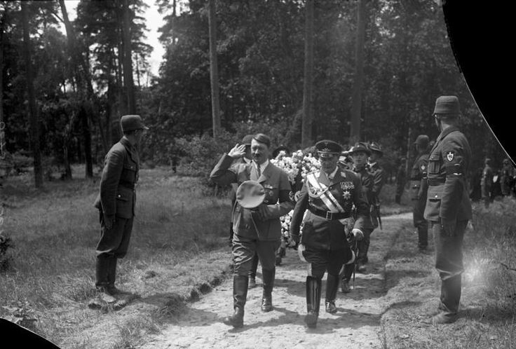 Hitler joins Herman Goering to pay his respects at the grave of Goering's first wife, Carin. Carin Axelina Hulda Goering was the Swedish first wife of the Reichsmarshal, who died of a heart attack in 1931, at the age of 43. This photo was taken on June 17, 1934 when Carin was re-interred  from her original grave in Sweden to a final resting place at Goering's hunting lodge named Carinhall after her. In 1991, Carin's remains were taken  back to Sweden to find a true final resting place.
