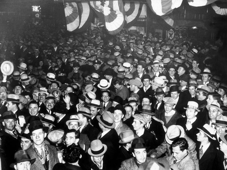 A joyous crowd celebrate the end of prohibition on Broadway, New York on 5th December 1933 :: NY Times