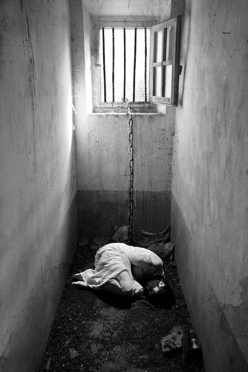 I'm a prisoner of a dungeon ........................... Lies inside my mind  .............................. Demons , they scream and cry  ........................ So I slammed the door   ............................... With me inside.....................................................                             -qpids love-