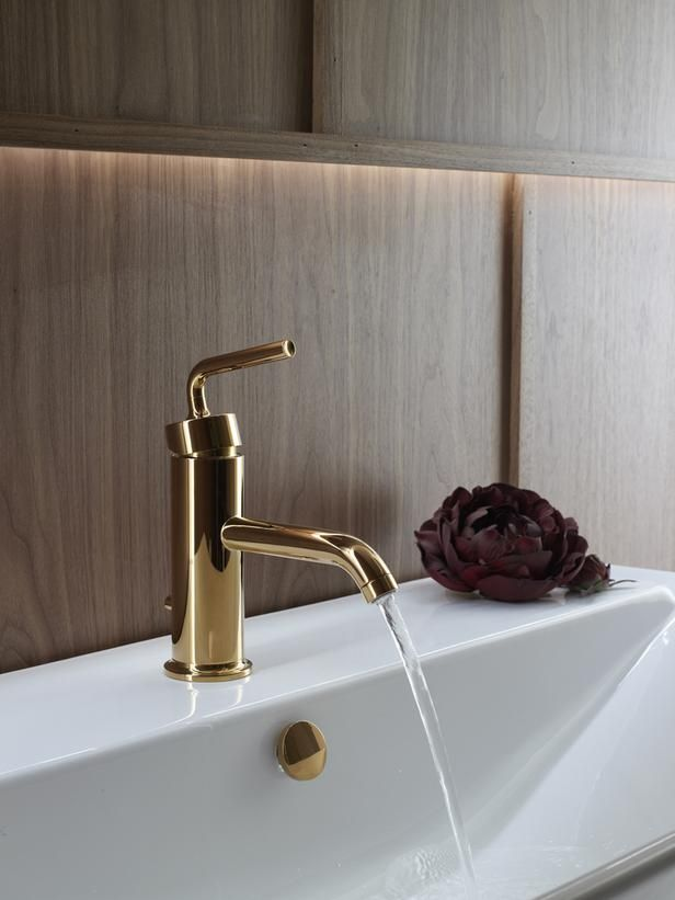 Gorgeous gold fixtures for the bathroom are in for 2015. For tips on decorating with the 2015 trends, read my blog at http://www.versastyledesign.com/en/2015-trends-and-colors-for-the-home